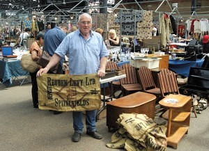 Roy Watt, who has been on the market since it started 10 years ago, is seen holding one of many sacks that he sells which were originally on the market in 1929.
