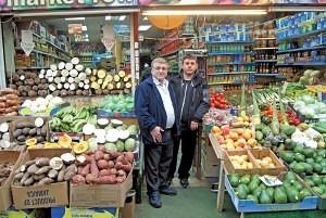 Simon Omar (left) of 'Brixton Foodland' Brixton Village Market Row