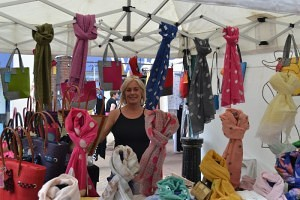 Jenny Jones and her colourful display of scarves and bags