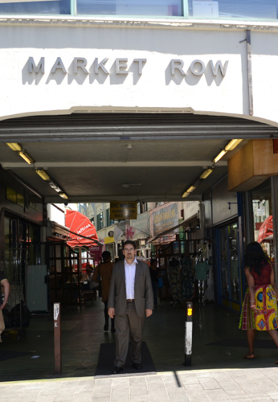 Market Manager Rachid Ghailane outside the entrance to Market Row